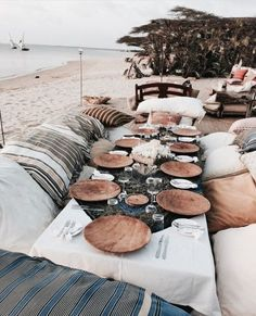 Gorgeous Rustic Beach Table With Wooden Plates And Lots Of Neutral Floor Cushions
