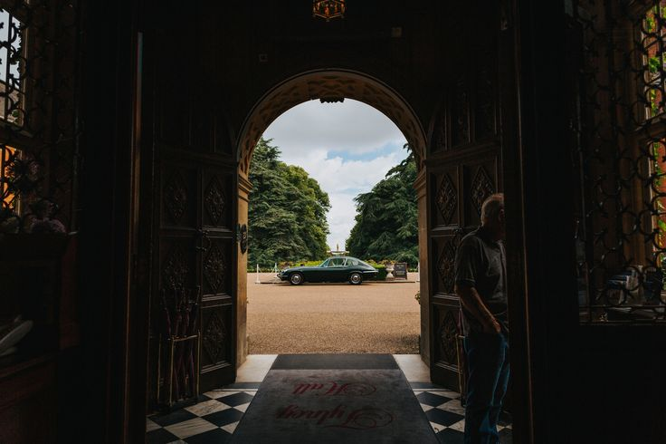 Travelling in style from Tylney Hall Hotel. Photo by Benjamin Stuart Photography #weddingphotography #classiccar #tylneyhallhotel