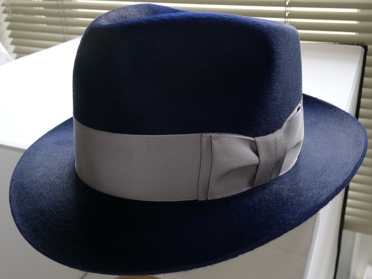 Navy... this hat and many others are made by Optimo Hats Chicago... one of the best milliners in the world. Here I wanted to talk about the color of hats. Look at this great two tone example. The light silver ribbon pairs perfectly with the rich navy body of the fedora. I have a hat very similar to this.