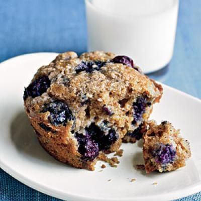 """Blueberry and Oatmeal Muffins: """"This family favorite gets a twist with the addition of whole-wheat flour and oatmeal. Tossing frozen blueberries with flour before adding them to the batter keeps them from turning the batter purple while they bake. If you use fresh blueberries, skip that step."""""""
