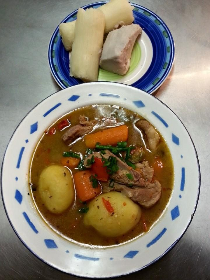 Hearty lamb stew with boiled cassava and taro cooking