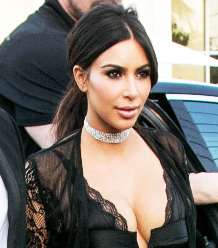Kim Kardashian wore a teased ponytail and a sultry smoky eye