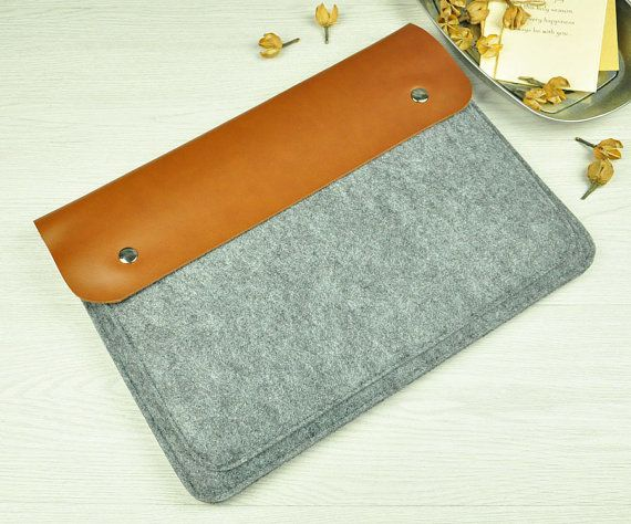 Our handmade laptop sleeves are made of felt and leather.  The special combo will show you more gorgeous and unique collections.  Our laptop sleeves are designed for :  11 Macbook Air 12Macbook 13 Macbook Air 13Macbook Pro with Retina Display( Macbook Retina 13inch in the size selections) 13 Macbook Pro 15Macbook Pro with Retina Display( Macbook Retina 15inch in the size selections) 15Macbook Pro  Color:Grey felt with brown leather as the images  We have chosen the felt and brown leather in…