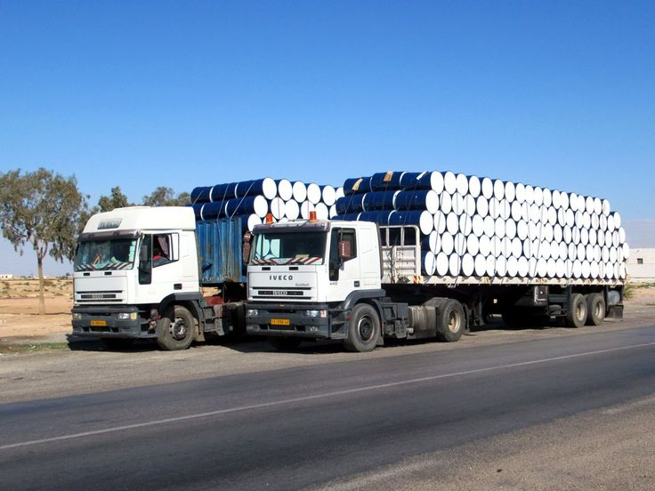 Trucks from Libya travel to Tunisia to collect empty drums.