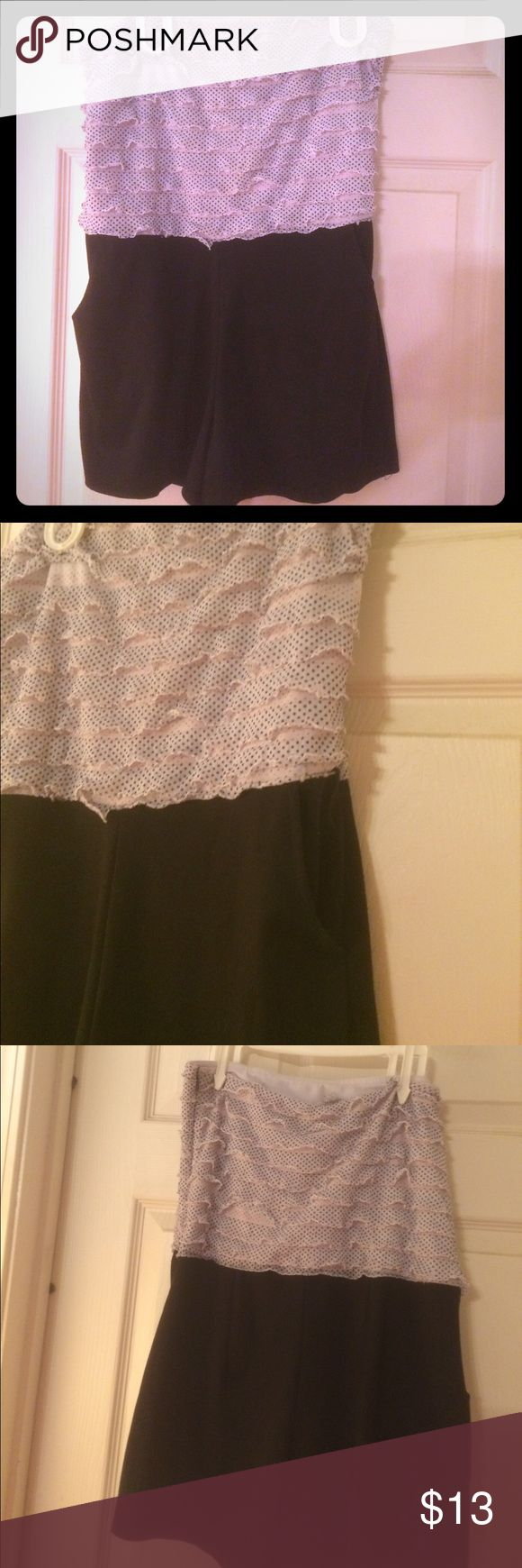 Charlotte Rouse black & white Strapless romper Pretty strapless Romper with ruffles on top of outfit black on bottom with pockets by Charlotte Rouse Charlotte Russe Other