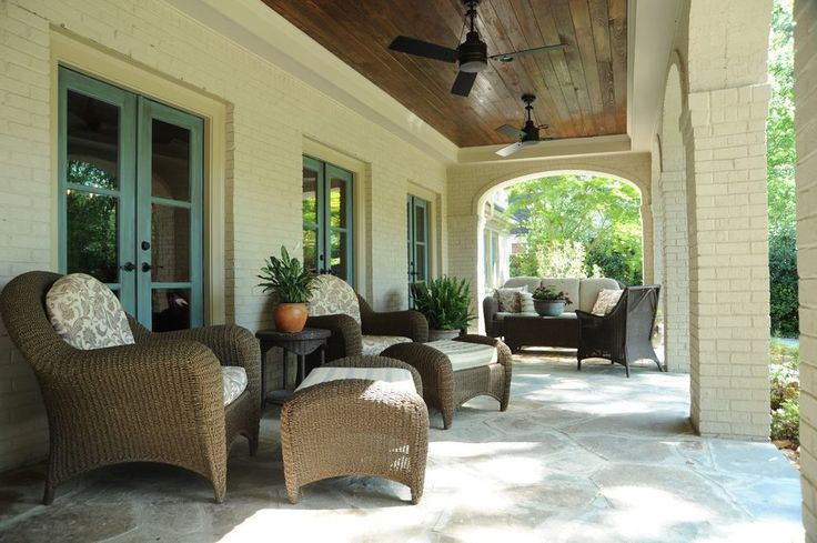 walkout basement patio porch traditional with wicker ottomans outdoor ceiling fans3-