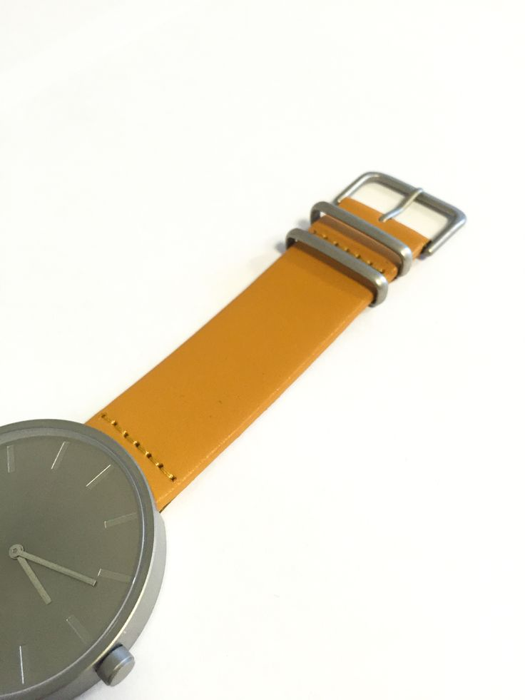The RAW featuring a light tan, sealed edge strap.