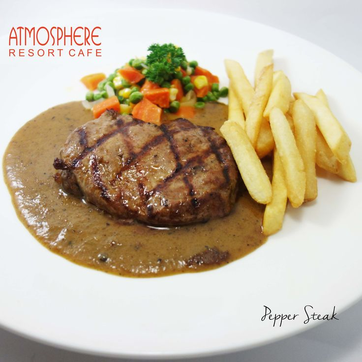 Grilled sirloin served with french fries & regular vegetables, in a tasty pepper sauce