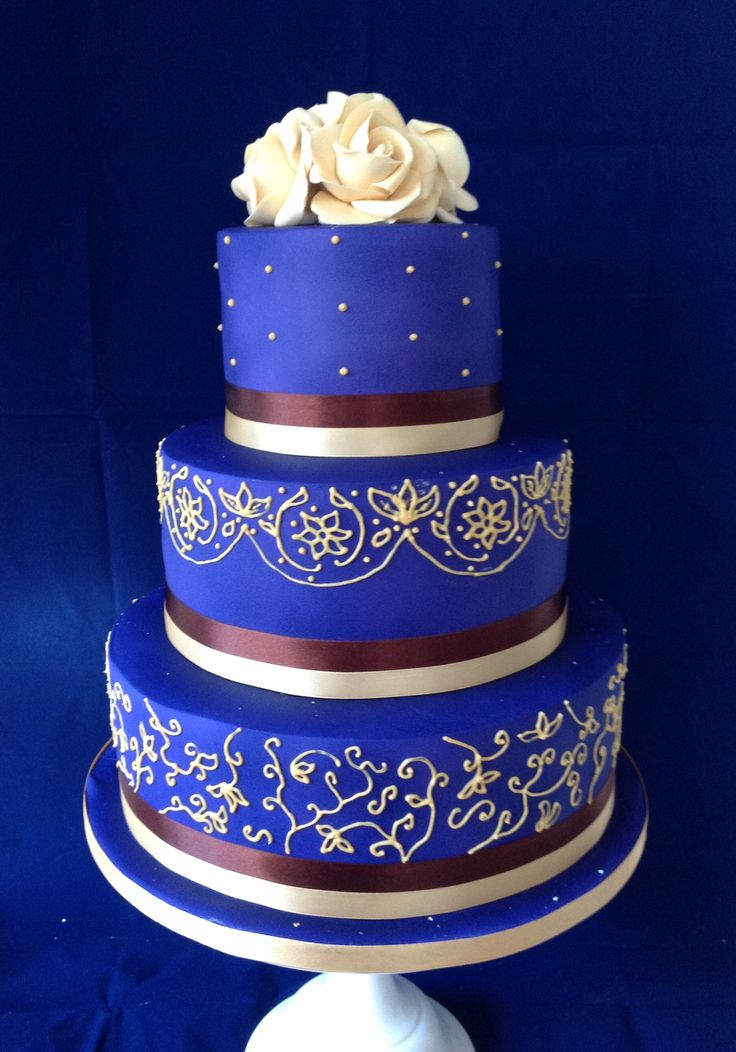 Vivid purple 3 tier wedding cake with gold piping and
