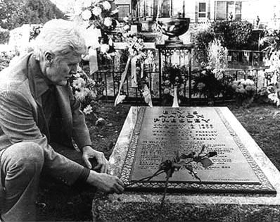 *VERNON PRESLEY:  laying a red rose (his son's favourite flower) on Elvis' tombstone.  Elvis Grave at Graceland