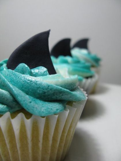 Shark capcakes.  Aiden loves Jaws so his birthday party is going to be a shark / Jaws theme.  We are making cupcakes similar to these.