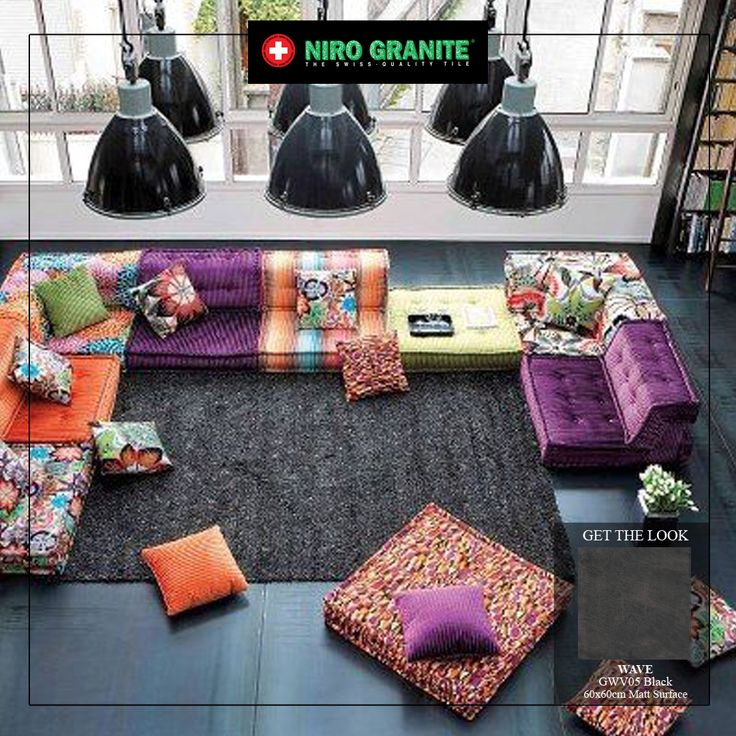 Thinking about doing something different for your living room? How about creating modern bohemian look? Put aside your old sofas and replace them with floor couches. Create a distinctive look by choosing different colors and patterns for each section of sofa and apply a neutral colour for flooring such as Wave GWV05 Black.