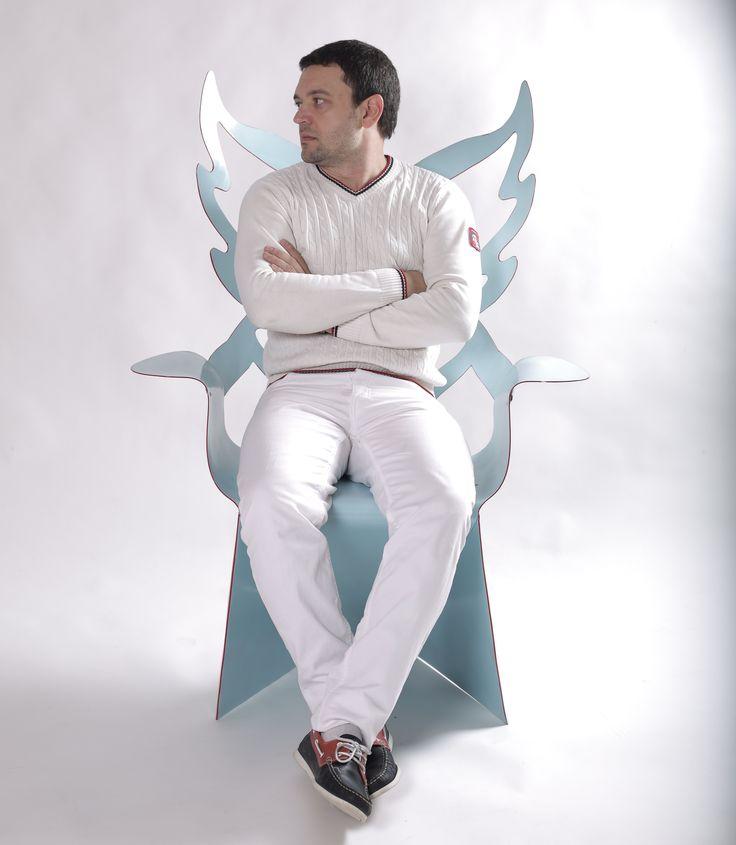 designer Alexander Shvets in the chair Angelic embrace