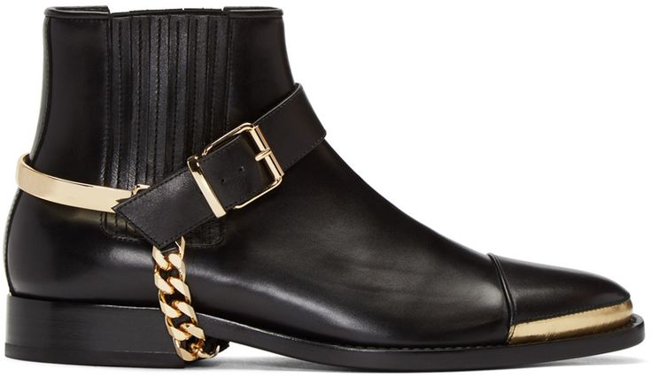 Ankle-high buffed leather Chelsea boots in black. Almond cap toe featuring metallic leather trim in gold-tone. Detachable harness featuring adjustable pin-buckle fastening and flat curb chain detailing. Covered elasticized gusset at sides. Tonal leather sole. Gold-tone hardware. Tonal stitching. Leather. Made in Portugal.
