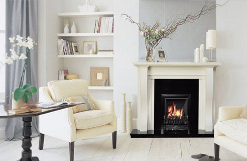 Love the fireplace decor and bookcase!