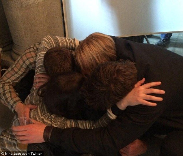 Jennifer Lawrence, Liam Hemsworth, Josh Hutcherson, and Woody Harrelson hug after shooting the last scene of The Hunger Games: Mockingjay - Part 2 (posted by producer Nina Jacobson)