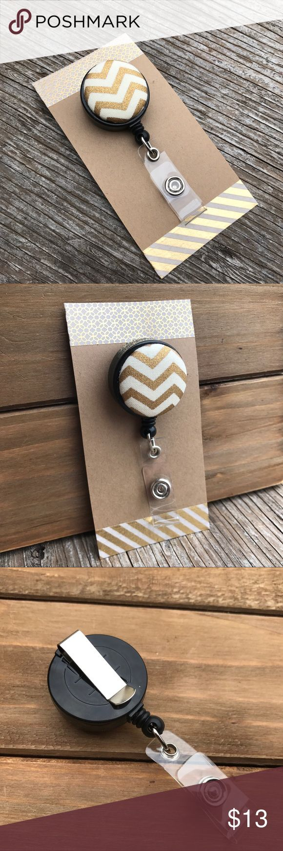 """Retractable Badge Reel•Chevron Print This adorable badge reel is the perfect way to snazz up your work attire! If you're required to wear one at work, why not spruce it up a bit!? Badge reels can be used for key holders, name tags, name tags, access cards, lanyards, belt loops and more. Made with gold & white chevron print fabric and securely adorned to a black retractable badge reel. Cord retracts up to 22"""". Comes with a clear plastic snap back & a swivel bottom. Handmade by me & brand new…"""