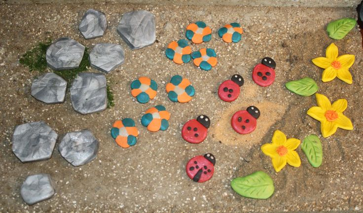 Fairy garden stepping stones you can make for less than 2$ Easy and fun, no special tools needed. You don't have to be a clay crafter to do these. Just get yourself a little brick of colored oven bake clay like Sculpey or Fimo and play with it... be careful..you might get hooked.