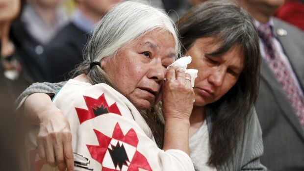 Residential School survivor Lorna Standingready (L) is comforted during the Truth and Reconciliation Commission of Canada closing ceremony…