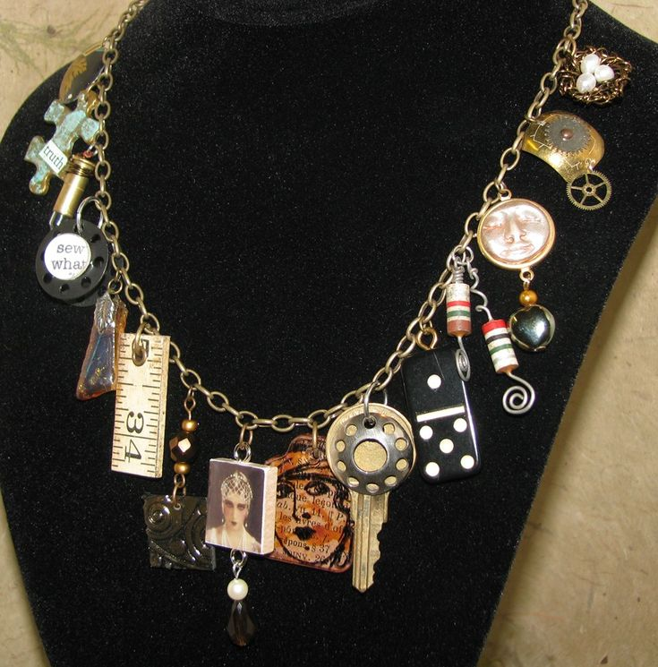 This adorable mixed charm necklace is handcrafted from found objects like Scrabble tiles, keys, bottle caps, bullet casings, buttons, dominoes, typewriter keys, resistors, a carpenters ruler, punched metal tins, sewing bobbins, watch parts, puzzle pieces, beetle wings, coins and beads. (Not all necklaces will have every item listed as part of a charm.) Other charms are crafted by me out of polymer clay using molds I have purchased, made myself or sculpted into one of a kind pieces. All the…
