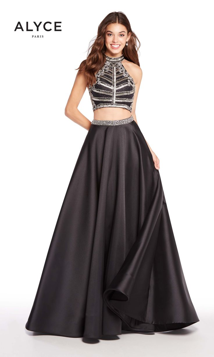 Left, right, Alyce 60195! The military style top of this two piece ball gown is achieved with silver horizontal beading which wraps around to create straps across the open back. The halter neckline also features silver beading. The full black mikado skirt is the finishing touch on this fun take on a stern pattern. Wear it to your next prom, pageant, or formal ball!