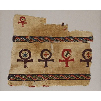 An Egyptian textile fragment, 400-600, woven with crux ansata/ankh symbols, the crosses and chi-rho representing the Christianisation of the ankh, an ancient Egyptian symbol of life. (Victoria & Albert Museum)