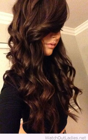 Dark chocolate brown color and curls