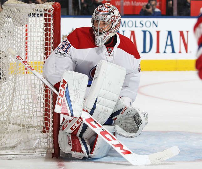 TORONTO, ON - FEBRUARY 25: Carey Price #31 of the Montreal Canadiens protects the corner against the Toronto Maple Leafs during an NHL game at the Air Canada Centre on February 25, 2017 in Toronto, Ontario, Canada. The Canadiens defeated the Maple Leafs 3-2 in overtime. (Photo by Claus Andersen/Getty Images)