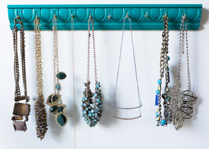 The problem with having lots of pretty jewelry is that eventually, you've got to keep it organized...or you'll wind up with a tangled mess. Jewelry boxes are okay, but again---they can result in ta...