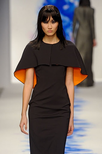 Cape dress, orange lining / Osman