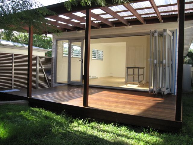 Polycarbonate roofing on a wooden pergola is an ideal solution for me