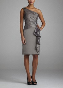 Look sensational in this stunning and sophisticated Mother of the Bride Dress!  One shoulder bodice features elegant ruched detail creating a flattering silhouette.  Cascading side ruffle adds tons of drama and dimension to this already fabulous ensemble.  Fully lined. Side zip. Imported poly/nylon/rayon blend. Dry clean.