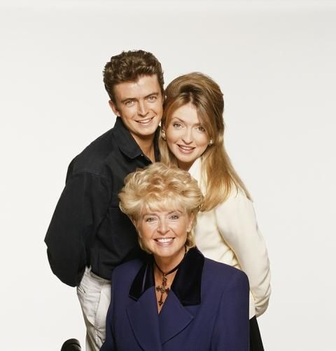 """Gloria Hunniford With Daughter Caron And Son Michael by Terry O'Neill   Television presenter Gloria Hunniford with her daughter Caron Keating, also a TV presenter, and her son Michael.  Limited Edition C-Print Signed and Numbered  16"""" x 16"""" / 20"""" x 20""""  24"""" x 24"""" / 30"""" x 30""""  40"""" x 40"""" / 48"""" x 48""""  60"""" x 60"""" / 72"""" x 72""""  For questions or prices please contact us at info@igifa.com     IGI FINE ART"""