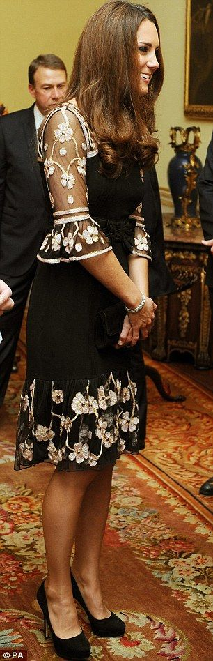 Duchess of Cambridge congratulates our Olympians and Paralympians at Buckingham Palace wearing an in an Alice Temperley dress with sheer black neckline and hem, featuring white embroidered flowers.