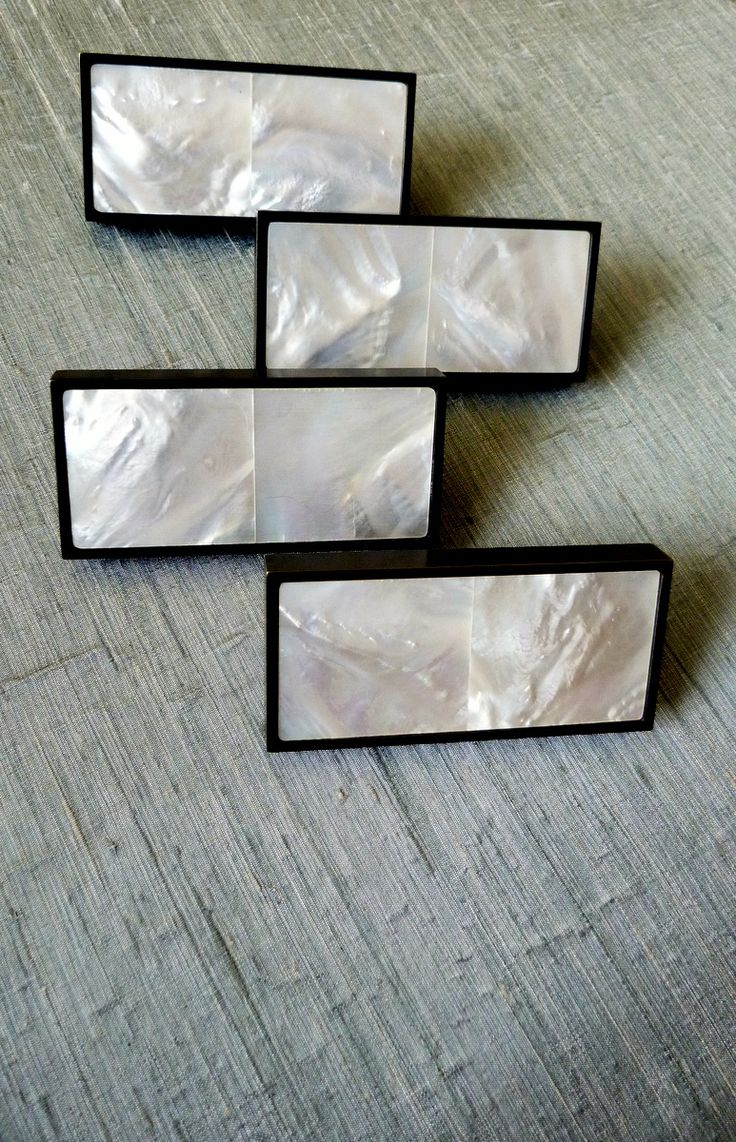 Bronze cabinet handles with Mother of Pearl inlay by Phillips and Wood.