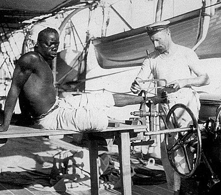 rare photograph showing African slaves being freed by the Royal Navy.