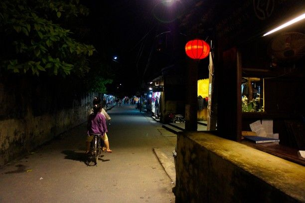 Hội An, Vietnam — by Earthseeing. A lonely street in Hoi An, a cold evening in January 2012. Two girls on a bicycle in one of the many empty alleys,...