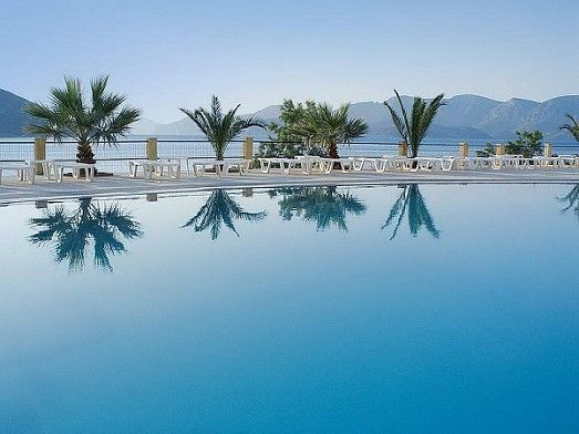 Outdoor Swimming pool- amazing view and a lovely pool bar,right above Massouri beach!!!!