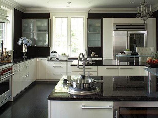 Marron Cohiba granite  Designer Angela Shannon used a 60-inch Wolf oven, high-gloss white Poggenpohl cabinets, Marron Cohiba granite countertops with metallic flecks and clear Starfire