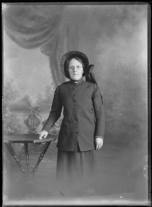 Studio portrait of unidentified women in Salvation Army uniform, with 'SA' bar collar brooch and bonnet, Christchurch c1900