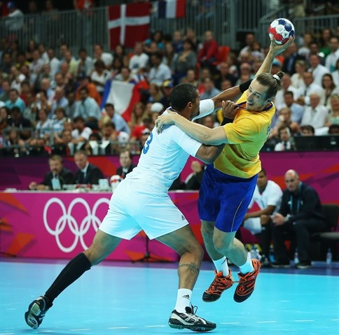 Kim Ekdahl du Rietz #25 of Sweden is defended by Didier Dinart #3 of France during the Men's Handball Gold Medal Match on Day 16. Add Around The Rings on www.Twitter.com/AroundTheRings & www.Facebook.com/AroundTheRings for the latest info on the #Olympics.
