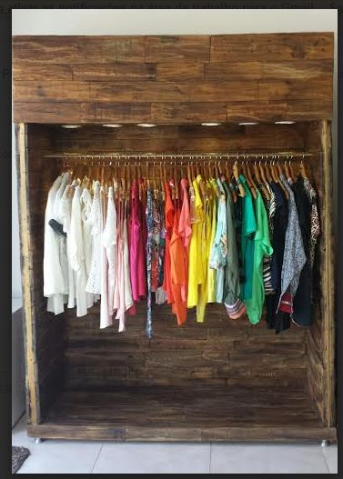#PalletCabinet, #RepurposedPallet Clothes Cabinet made with metal structure and covered with pallets and with built-in light ...