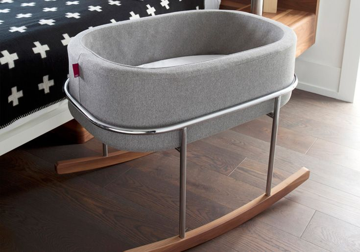 Rockwell Bassinet from Monte Design is new for Spring 2015 and brings a contemporary look to any nursery or home (Heather Grey Basket/Chrome/Walnut Base).