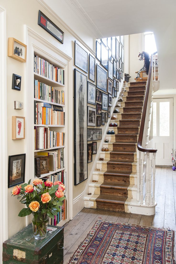 A rocking horse stands at the top of the stairs