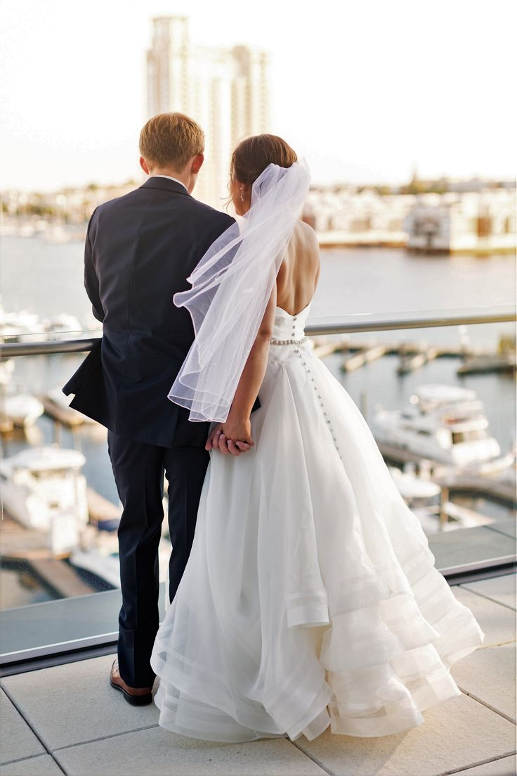 Bride and groom reflecting on their big day.  Harbor Tower Events in Baltimore