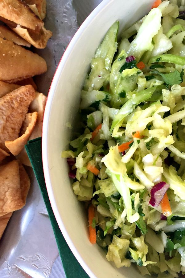 Irish Slaw Dip | 1 head green Savoy cabbage, shredded (about 6 cups) 2 green onions, finely chopped 1/2 cup grated carrots 1/4 cup red cabbage, shredded 1 small white onion, grated 1 cup cilantro, coarsely chopped 1 4 oz. can jalapenos, chopped, do not drain 1 cup drained peperoncinis 1/2 cup olive oil 2 Tbsp. rice vinegar 1/2 tsp. garlic powder 1 1/2 tsp. cumin Kosher salt Fresh ground black peppe