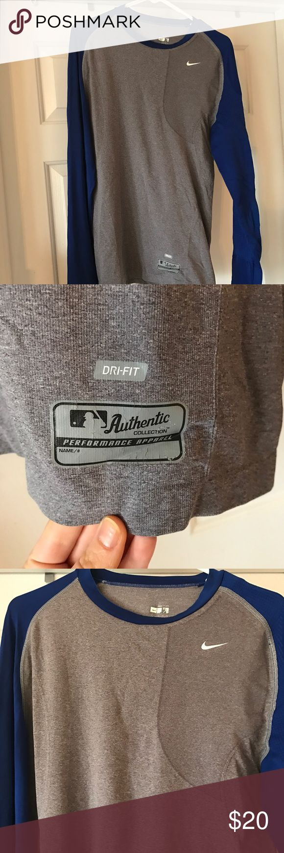 Nike men's Thermal wear This is a really cool shirt! My husband was a left handed college pitcher and this is a dri fit thermal shirt has special thermal elements in the left chest and arm. You can see the darker gray on the left chest showing where the additional thermal is. Size XL Nike Shirts Tees - Long Sleeve