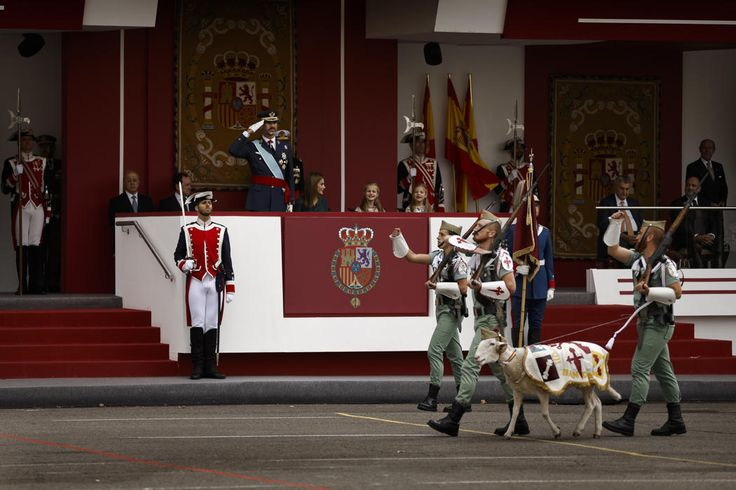 A goat, the mascot of La Legion, an elite unit of the Spanish Army, marches in front of the tribune where Spain's King Felipe, Queen Letizia, Crown Princess Leonor and Princess Sofia attend a military parade during the holiday known as Dia de la Hispanidad, Spain's National Day, in Madrid, Spain, Sunday, Oct. 12, 2014. King Felipe VI presided the military parade as they celebrate the day Christopher Columbus discovered America in the name of the Spanish Crown.