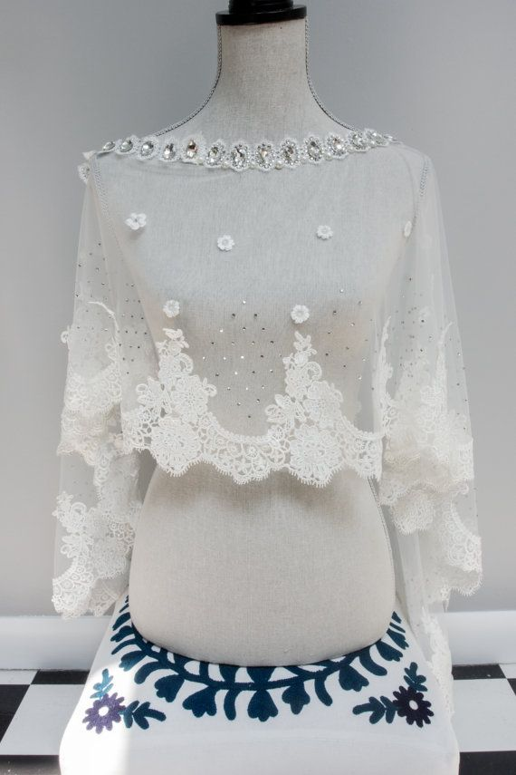 Introducing the Monroe, a hand beaded and constructed bridal shrug guaranteed to impress! This stunning Bridal Shrug is made with delicate
