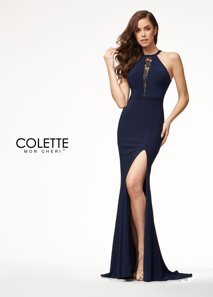 Colette for Mon Cheri CL18289 - This alluring yet simple dress is a crowd pleaser! It is a form-fitting jersey dress featuring a high neck line with a beautiful lace filled plunging detail, a sexy slit, and an amazing open back!